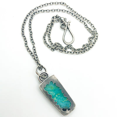 back side view of Sterling Opalized Wood Pendant Necklace by Berlin Randall