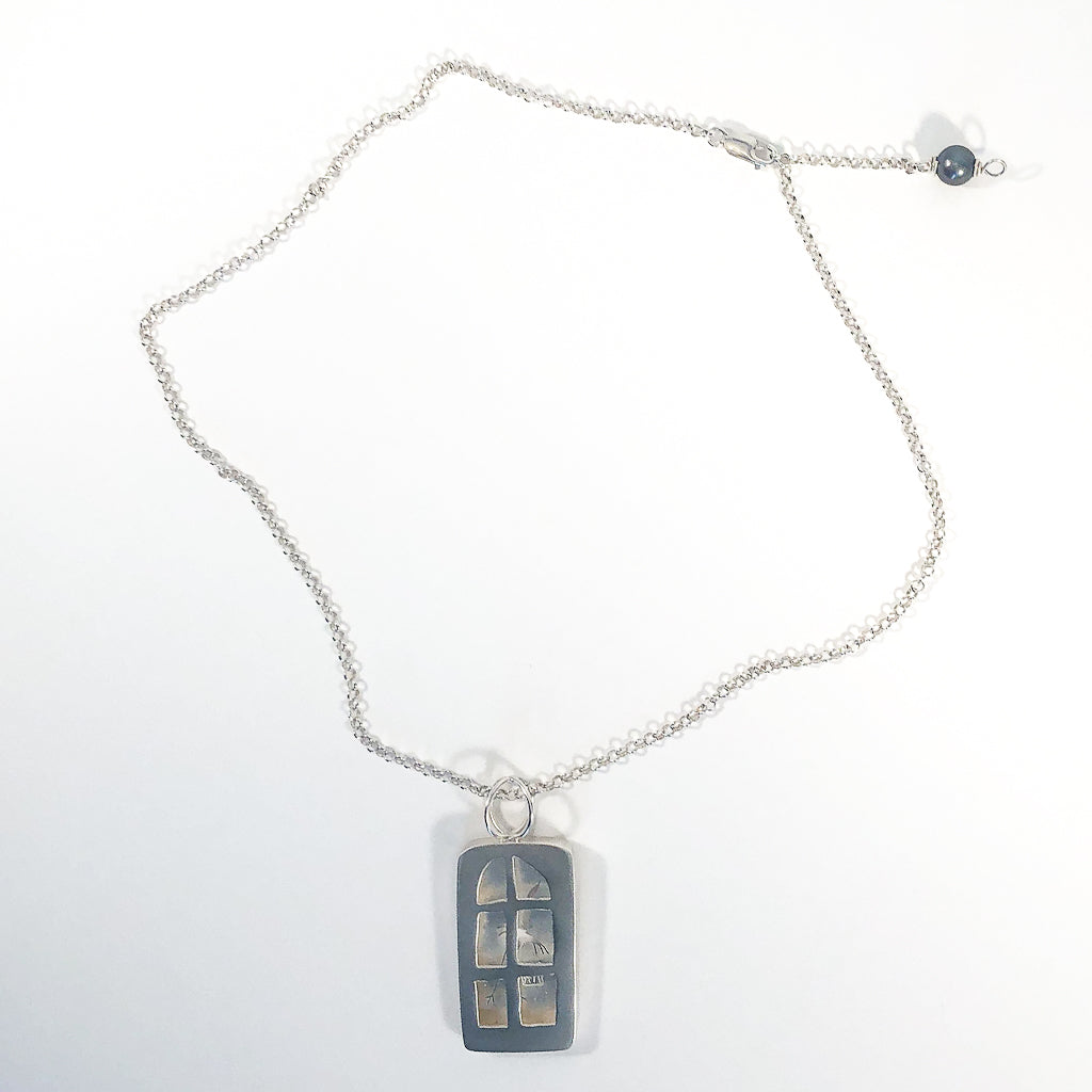 flat lay of Windows of Opportunity Necklace by Ling-Yen Jones