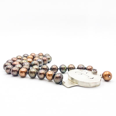 side angle flat lay of Sunstone Necklace with Bronze Pearls and Unmentionables Clasp by Ling-Yen Jones