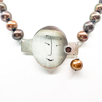 detail view of Sunstone Necklace with Bronze Pearls and Unmentionables Clasp by Ling-Yen Jones
