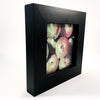 side angle view of pastel painting Apples in black wooden frame by Wanda Cox