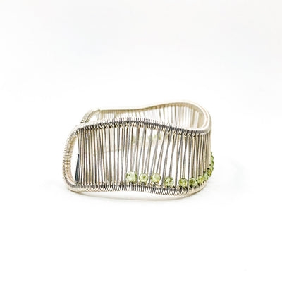 right side view of Sterling Wave Cuff with 3mm Faceted Peridot by Tana Acton
