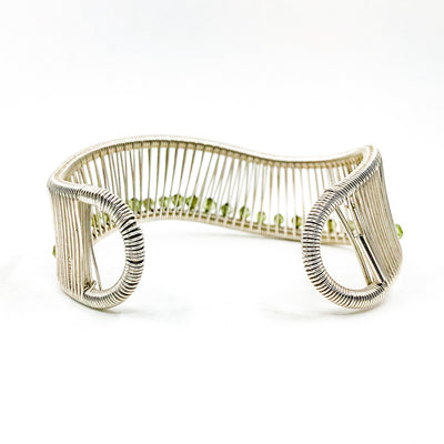 back side view of Sterling Wave Cuff with 3mm Faceted Peridot by Tana Acton