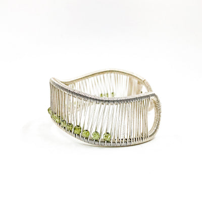 left side view of Sterling Wave Cuff with 3mm Faceted Peridot by Tana Acton