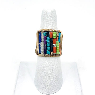 Gold Filled Ring with Rows of Multi Color Heishi Beads by Tana Acton on white display finger
