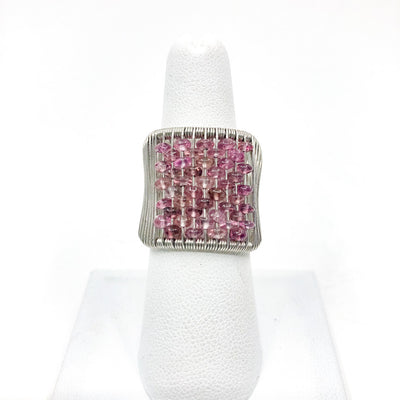 Sterling Ring with Pink Tourmaline by Tana Acton on white ring display finger
