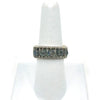 Sterling Ring with Round Faceted Labradorite Beads by Tana Acton on white ring display finger