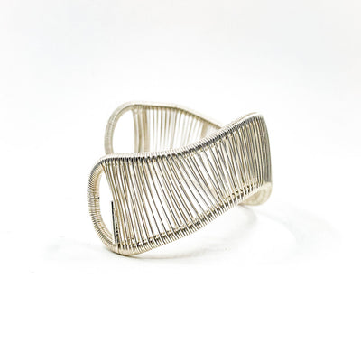 right side view of Sterling Asymmetrical L Wave Cuff by Tana Acton