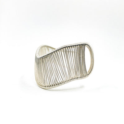 left side view of Sterling Asymmetrical L Wave Cuff by Tana Acton