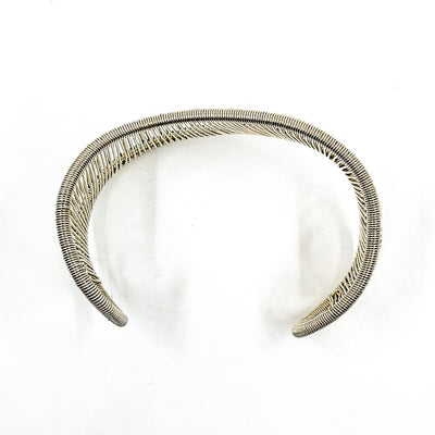 over top view of Sterling Asymmetrical L Wave Cuff by Tana Acton