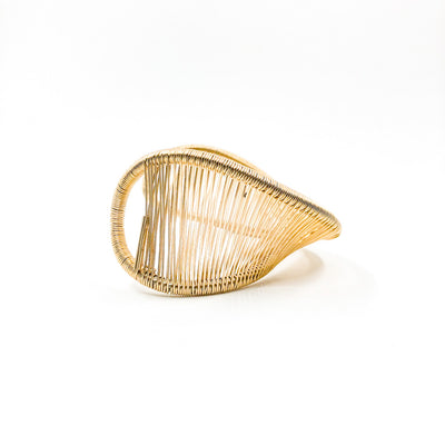 side angle view of Gold Filled Center Mobius Cuff by Tana Acton