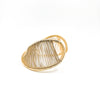 left side view of Gold Filled Center Mobius Cuff by Tana Acton