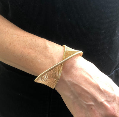 Gold Filled Center Mobius Cuff by Tana Acton worn on model