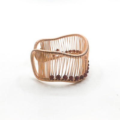 right side view of Rose Gold Filled Wave Cuff with Garnet by Tana Acton