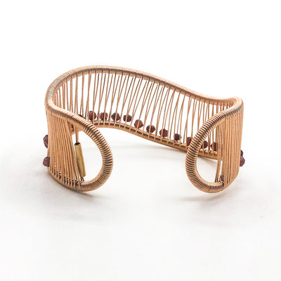 back side view of Rose Gold Filled Wave Cuff with Garnet by Tana Acton