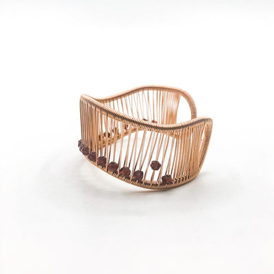 left side view of Rose Gold Filled Wave Cuff with Garnet by Tana Acton