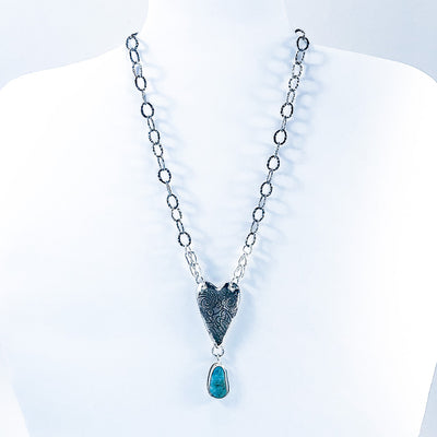 Sterling Heart Necklace with Turquoise by Maria Sjostrom on white display bust