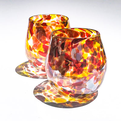pair of Red, Gold & Silver Wine Tumblers by Nate Nardi on white background with colorful shadow reflecting
