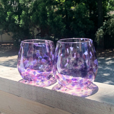 a pair of Purple & Pink Speckled Wine Tumbler by Nate Nardi on deck rail