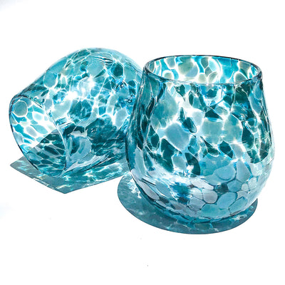 pair of Teal Speckled Wine Tumblers by Nate Nardi against white background with colorful shadows reflecting
