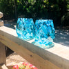 pair of Teal Speckled Wine Tumblers by Nate Nardi on wood hand rail in outdoor setting