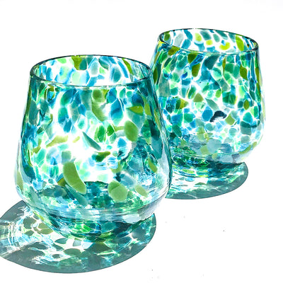 pair of Blue & Green Speckled Wine Tumblers by Nate Nardi against white background with colorful cast shadows