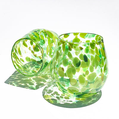 pair of Spring Green Wine Tumblers by Nate Nardi against white backdrop with colorful cast shadows