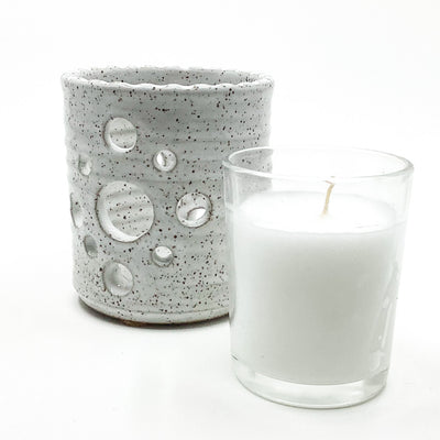 glass votive with candle along side pottery Votive Holder by Terrie Ponder Watch