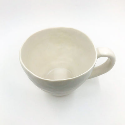 over top angle view of White Latte Cup by Nona Kelhofer