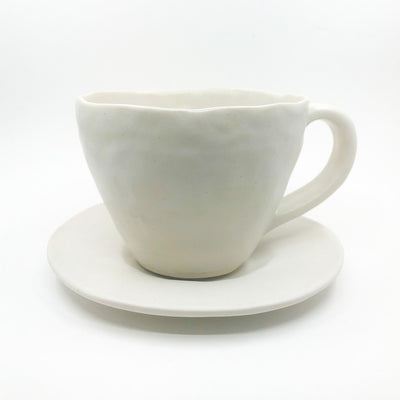 White Latte Cup and Saucer by Nona Kelhofer