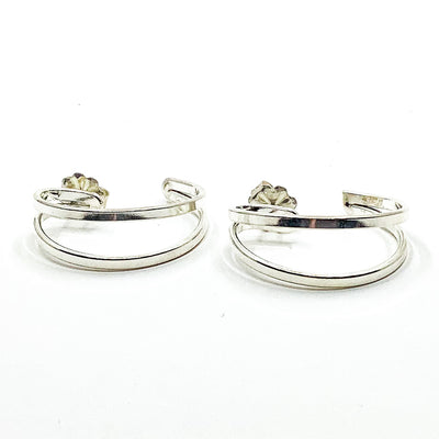 side angle view of Sterling Looped End Earrings by Judie Raiford