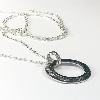 "Sterling Silver Necklace with Double Circle and Oxidized Center Circle on 30"" Sterling chain angled view"