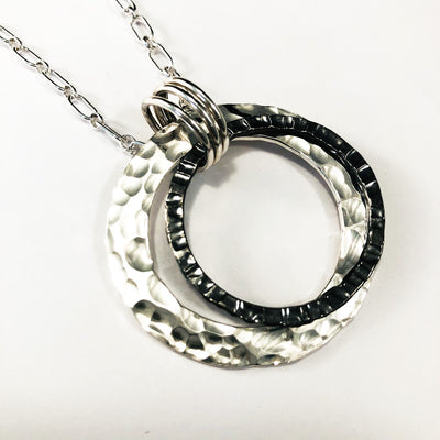 "Sterling Silver Necklace with Double Circle and Oxidized Center Circle on 30"" Sterling chain close up detail of pendant"