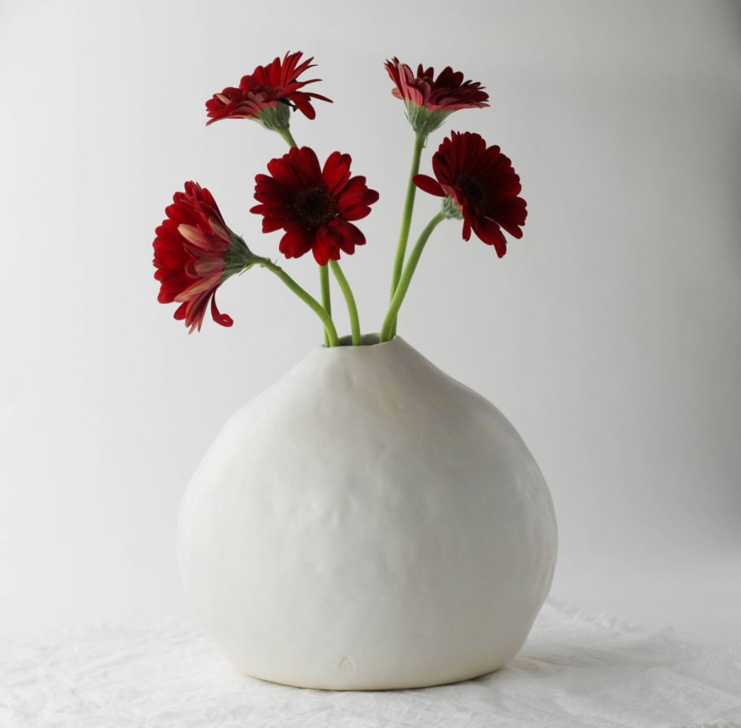 Gourd Vase by Nona Kelhofer with Red Daisies in it