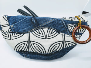 "Artisan "" What Not Bags"" made from upcycled jeans with cream and black ethnic bow tie detail"