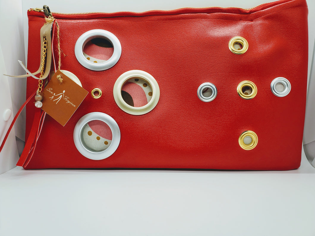 Artisan oversized rich red clutch with grommet detail