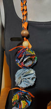 Load image into Gallery viewer, Graduation Lei orange and black ribbon with denim and African print flowers