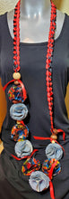 Load image into Gallery viewer, Graduation Lei red and black ribbon with denim and African print flowers
