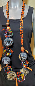 Graduation Lei orange and black ribbon with denim and African print flowers