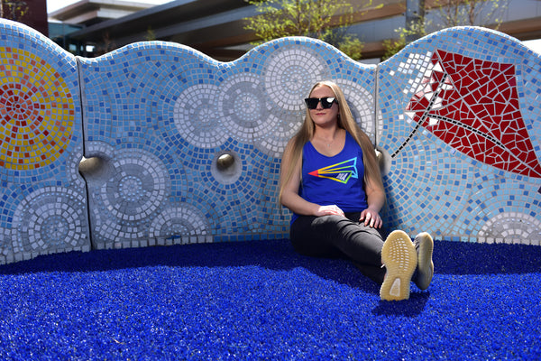 A female model wears the BNA Pride tank outdoors at BNA.