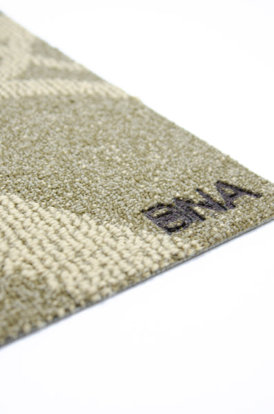 Detail of Brand on BNA Carpet Doormat