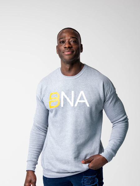 Man wearing BNA logo sweatshirt in gray