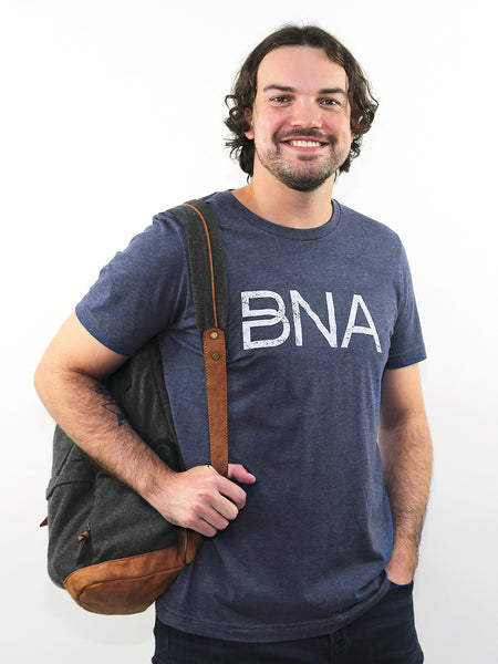Male model wearing Heather Navy BNA Logo Tee.
