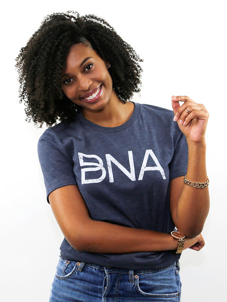 Female model wearing Heather Navy BNA Logo Tee.