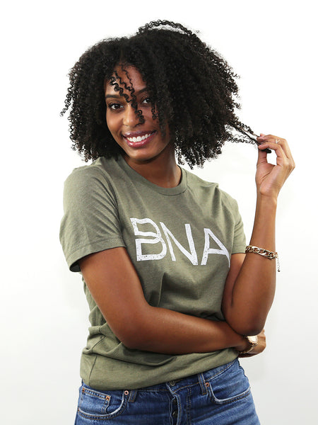 Female model wearing Heather Olive BNA Logo Tee.