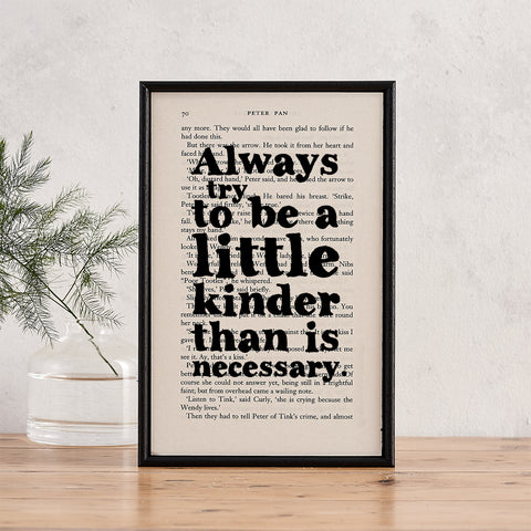 """""""Always try to be a little kinder than is necessary"""" in black bold text over a framed page from the book Peter Pan"""
