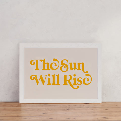 """""""The sun will rise"""" in yellow text over a stone coloured background"""