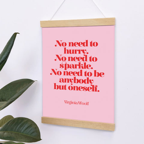 """""""No need to hurry, no need to sparkle, no need to be anybody but oneself."""" red text over a pink background."""