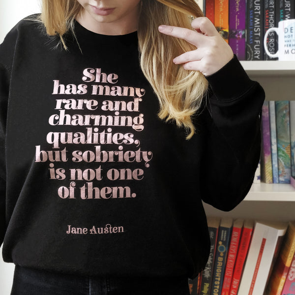 She has many rare and charming qualities, but sobriety is not one of them | Jane Austen Slogan Jumper.