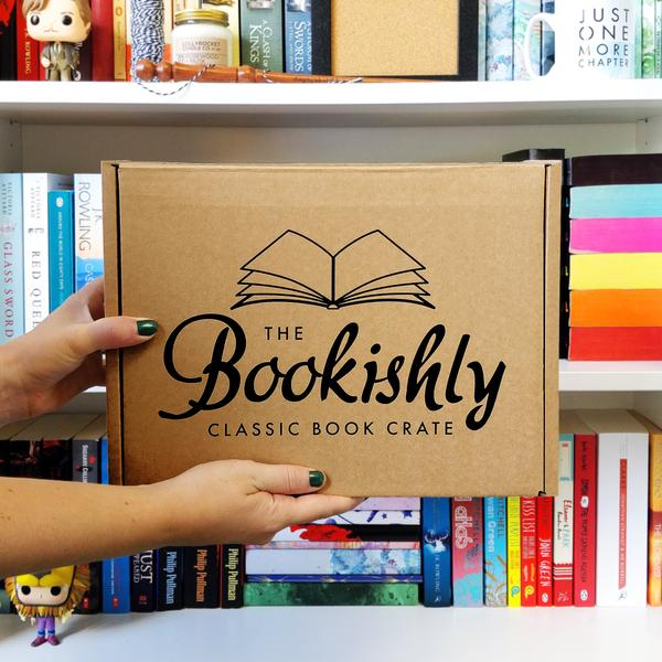 The Bookishly Classic Book Crate box held in front of a book shelf